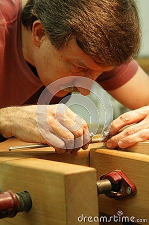 Woodworker Making Close Measurement