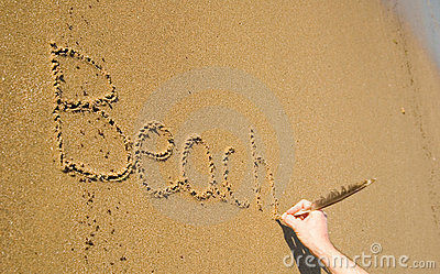 Word Beach written on the sand