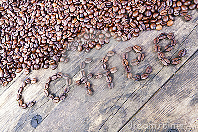 The word coffee beans laid out the wood table.