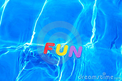 Word FUN floating in a swimming pool