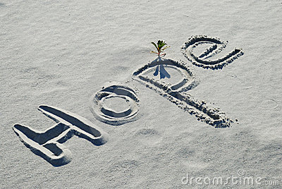 The word Hope written in the sand