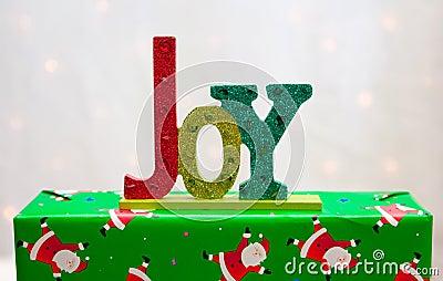 The word JOY on a Christmas present