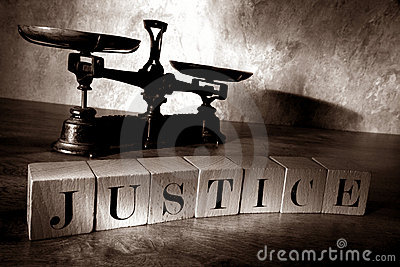 The Word Justice in Letter Blocks and Law Scale