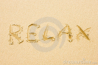 Word Relax written on sand