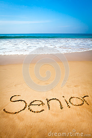 Word Senior Written in Sand, on Tropical Beach