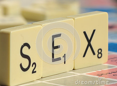 Letters from a Scrabble game is spelling Sex.