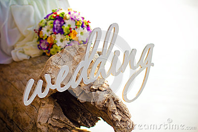 Word wedding, bouquet and rings