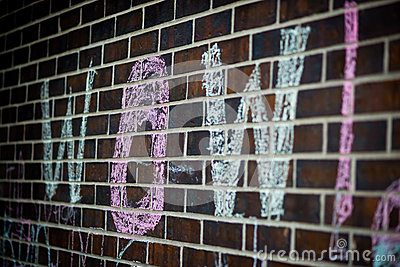 Word WOW Written in Chalk on Brick Wall
