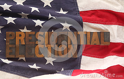 The words presidential election on a USA flag
