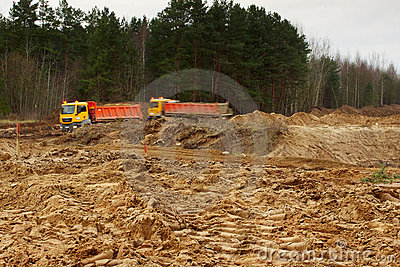 Work of digging ground and machines truck royalty free for Digging ground dream meaning