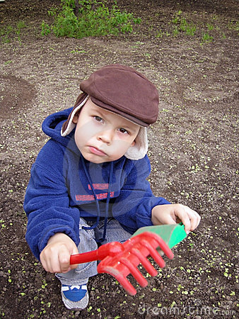 Free Work In A Garden. The Help To Parents. Stock Images - 6153734