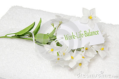 Work-Life-Balance spa decoration with white jasmine and a sign