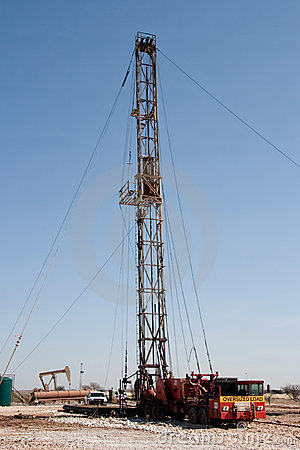 Work Over Rig, Pumpjack, and a Drilling Rig