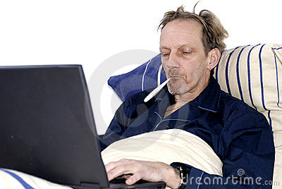 Workaholic, Sick In Bed With Laptop. Royalty Free Stock Photo - Image: 1875235