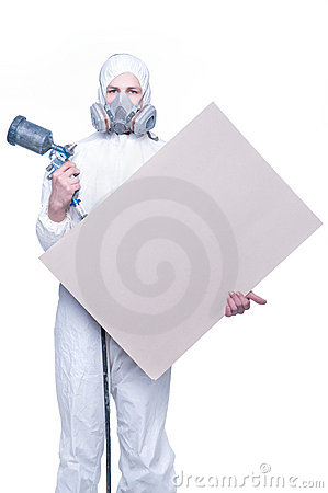 Worker with airbrush gun and blank