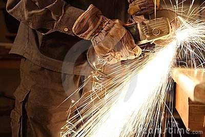 Worker with angle grinder only Hands