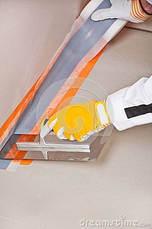Worker apply hydro insulation tape