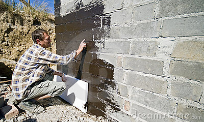 Worker applying polystyrene