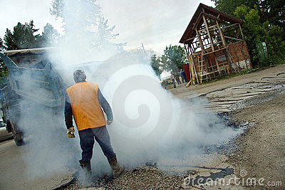 Worker at asphalting works Editorial Stock Image