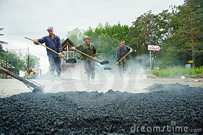 Worker at asphalting works Editorial Photo