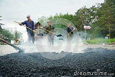 Worker at asphalting works Editorial Photo