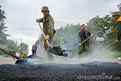 Worker at asphalting works Editorial Image