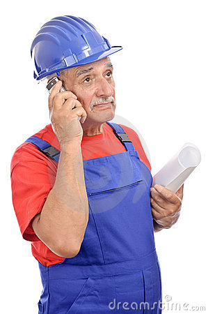 Worker with blueprints talking phone