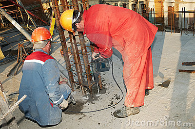 Worker builder drill and concrete