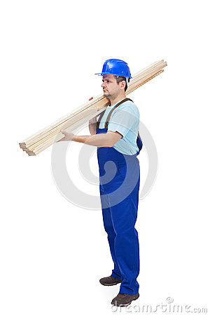 Worker carries wooden planks