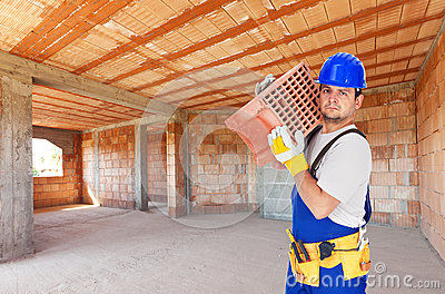 Worker carry brick on construction site