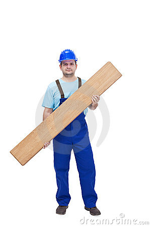 Worker carrying laminate flooring