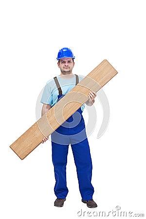 Worker carrying laminate flooring