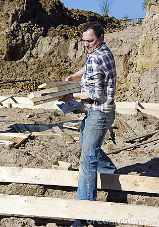 Worker Carrying Planks Stock Image - Image: 4987831