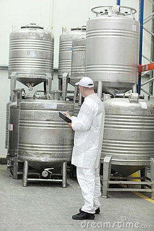 Worker checking stocks in foodstuff storehouse