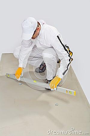 Worker checks cement base