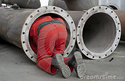 Worker checks a steel pipe
