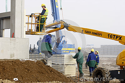 Worker on cherry picker in construction site Editorial Image
