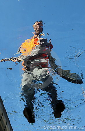 Worker cleaning glass