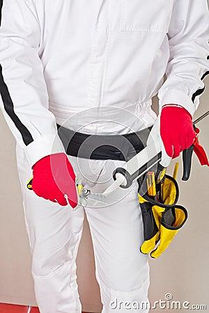Worker cuts cap sealant silicon