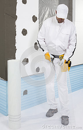 Worker cutting a fiber mesh