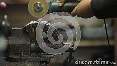 Worker cutting metal workpiece with circular saw stock video