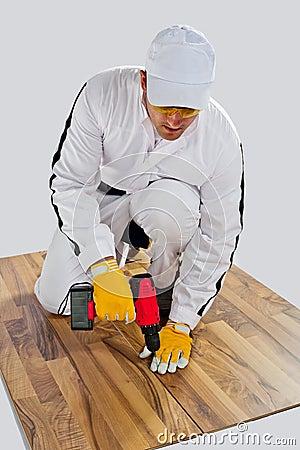 Worker drilled wooden floor cracks
