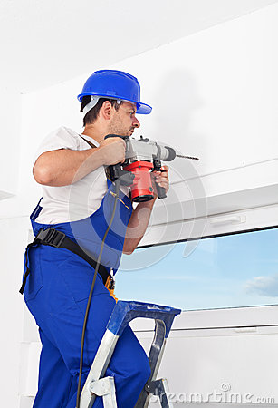 Worker drilling hole