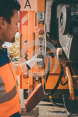 Free Worker Emptying Dustbin Into Waste Vehicle Royalty Free Stock Photography - 108821007