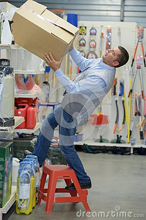 Free Worker Falling Off Ladder In Warehouse Stock Photos - 100301613