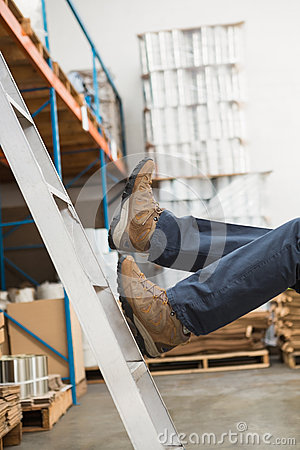 Free Worker Falling Off Ladder In Warehouse Royalty Free Stock Photos - 49286618