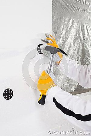 Worker fixing a dowel
