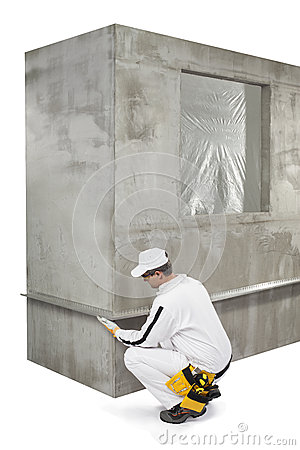 Worker fixing a lath on a corner