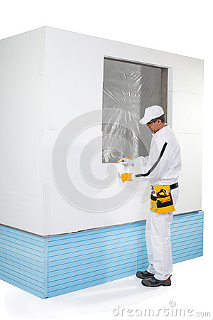 Worker fixing a small insulation panel