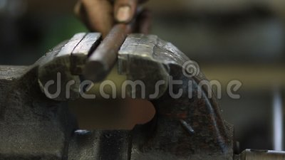 Worker fixing workpiece with clamp equipment stock video footage